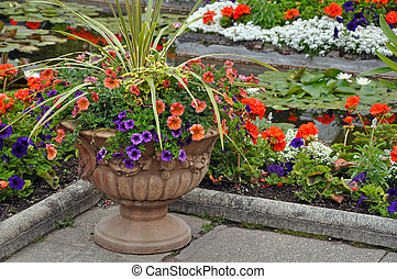 Decorative petunia planter next to garden pond