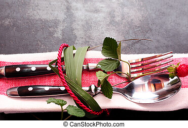 Decorative place setting tied with leaves and rope