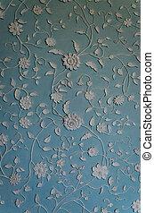 Decorative plasterwork on a wall