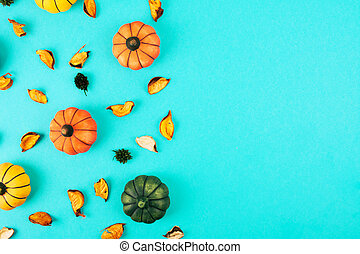 Decorative pumpkins with fall leaves frame.