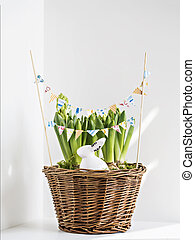 Decorative rabbit in flower pot with paper garland.