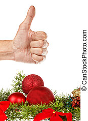 red ornaments with pine or fir for Christmas or New Year tree witrh human thumb up