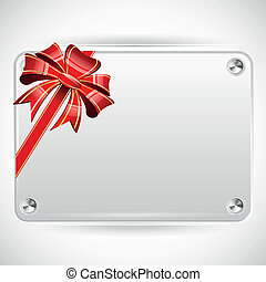 Decorative red ribbon and bow on a background of white plate with copyspace