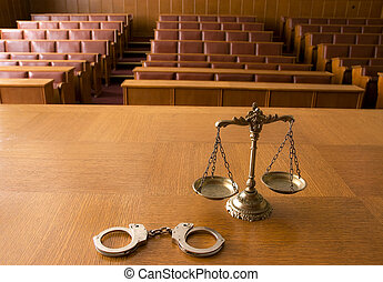 Decorative Scales of Justice and handcuffs - Symbol of law...