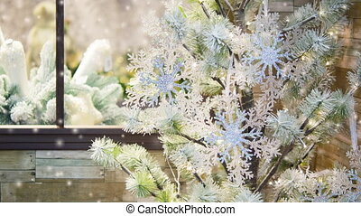 Decorative snow-covered fir-tree decorated