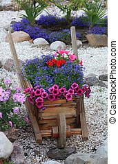 Decorative stand for flowers (type of truck) in landscape recreation area