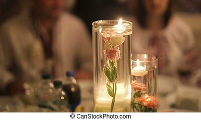 Decorative table setting pan with candle lights at a wedding...