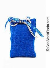 Decorative textile sachet pouch with a ribbon and bow on...