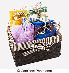 Decorative textile sachet pouches in gift box on white ...