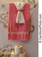 Decorative towels and paper in luxury bathroom