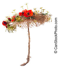 decorative umbrella of burlap, mats and artificial flowers poppy