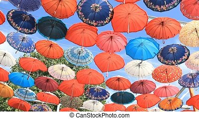 Decorative umbrellas on the blue sky. - Decorative umbrellas...