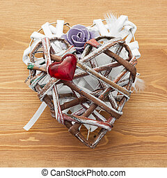 Decorative valentine heart made of paper and fabrics