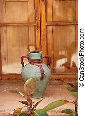 decorative vase against wood background