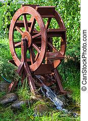 Decorative water wheel in the garden, element of modern...