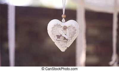 decorative white heart on the rope as a wedding decor.