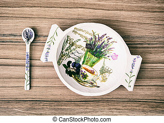 Decorative wooden bowl and spoon on the wooden background, Easter decoration