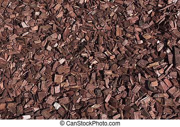 Decorative wooden brown chips, bark for the garden. Top view. Pattern.
