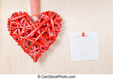 Decorative wooden heart with empty label