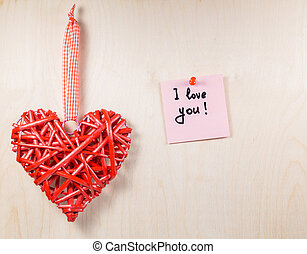 Decorative wooden heart with label