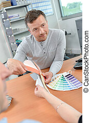 Decorator and client choosing a colour