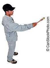 Decorator holding paint brush