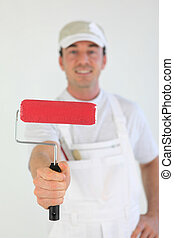 Decorator holding paint roller