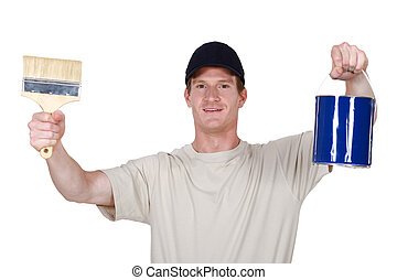 Decorator holding paint tin and brush