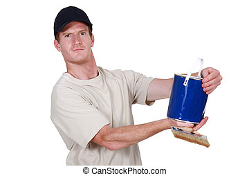 Decorator holding tin of blue paint