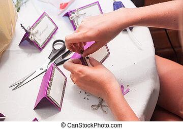 decorator makes the invitation cards - hand of decorator...
