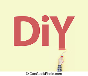 Decorator painting DIY on a wall