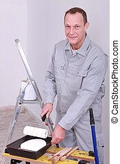 Decorator preparing paint roller