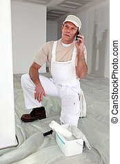 Decorator speaking to dissatisfied customer over the phone