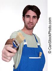 Decorator stood with paint brush