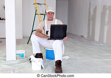 Decorator with a laptop