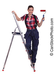 Decorator with red paint and a roller