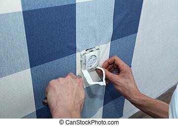decoratore, con, bisturi, appendere, parete