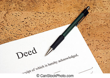 A closeup shot of deed forms ready for signing.
