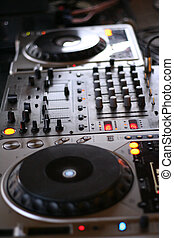 Deejay Decks - a deejay console with mixers in the middle