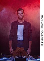 Deejay in club - Portrait of young deejay in night club