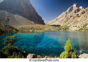 deep blue lake in Fann mountains at sunrise