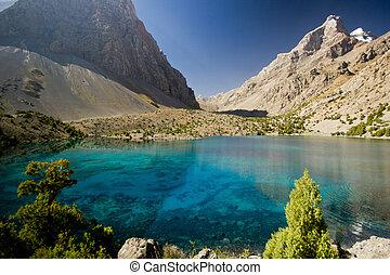 deep blue lake in Fann mountains at sunrise