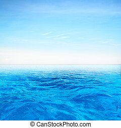 Deep blue sea over blue sky background