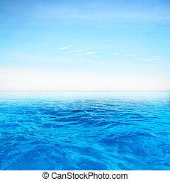 Deep blue sea over blue sky background
