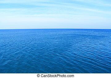 Deep blue sea with clear sky