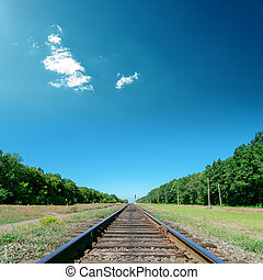 deep blue sky over old railroad