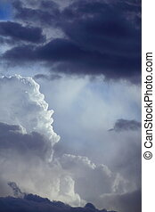 Deep blue sky with storm clouds before rain