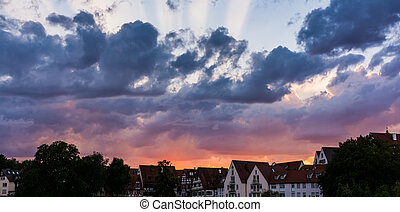 Deep Burning Red Purple Blue Ray Sunset over German Cottages in Ulm