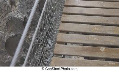 Deep canyon in 'El Caminito del Rey' with final bridge,...