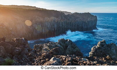 Deep cliff over atlantic ocean at sunset with ray lights timelapse